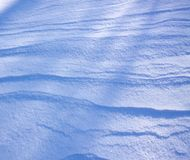 Fresh snow surface in sunny winter day. Fresh wavy snow surface in sunny winter day Royalty Free Stock Photos