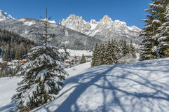 Fresh snow. The town of Pozza di Fassa covered under a coat of fresh snow. The parsec peaks are visible in the background, next to Ciampedie, one of the two Stock Photos