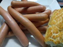 Polish frankfurters on a plate. With fresh soft white bread Royalty Free Stock Image