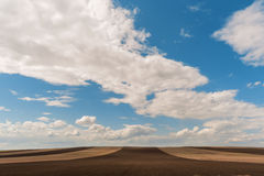 Fresh soil. Spring arable and a blue sky , Khakassia Royalty Free Stock Photography