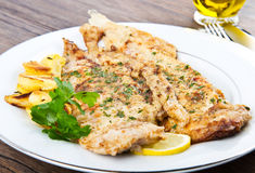 Fresh sole served with potatoes Stock Photos