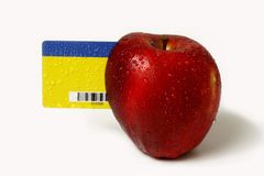 Fresh solution. Red apple and card on a white background Royalty Free Stock Photo