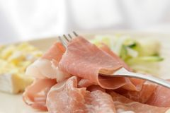 Prosciutto ham with cheese and salad in white background Royalty Free Stock Photo