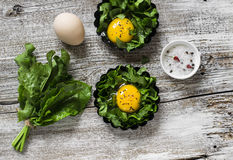 Fresh sorrel and eggs , ingredients for making baked eggs Royalty Free Stock Images