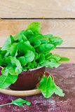 Fresh sorrel leaves. On a plate on the old wooden background.. health and diet food Royalty Free Stock Images