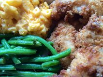 Fresh soul food meal. Delicious comfort food including fried chicken finger strips, baked macaroni and cheese, and green beans. Some consider this a healthy meal Stock Image