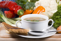 Fresh soup. A bowl of fresh soup with some of the ingredients in the background stock photo