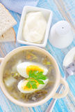 Fresh soup. Green soup with boiled eggs royalty free stock photography