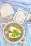 Fresh soup. Green soup with boiled eggs stock photo