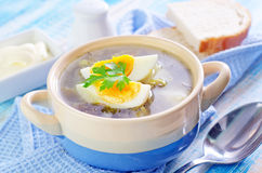 Fresh soup. Green soup with boiled eggs stock photos