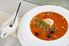 Fresh soup with herbs and olives Stock Photography