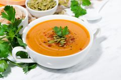 fresh soup of pumpkin and lentils on white background Stock Photos