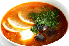 Fresh soup with sauce and lemon royalty free stock image