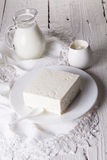 Fresh sour cream and  quark. On a white table Royalty Free Stock Photography