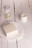 Fresh sour cream and  quark. On a white table Stock Photo
