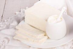 Fresh sour cream and  quark. On a white table Stock Photos
