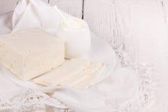 Fresh sour cream and  quark. On a white table Royalty Free Stock Photos