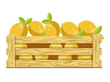 Fresh sour lemons with leaves in wooden box for sale Royalty Free Stock Image