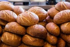 Fresh sourdough bread stacked in a bakery ready to sell and eat stock photo