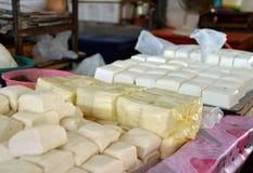 Fresh handmade tofu on a market shelf in Malaysia. Fresh soybean tofu, handmade. Traditional market stand in Malaysia. Typical Asian food Stock Photo