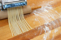 Fresh spaggeti just been produced. On wooden table Stock Photography