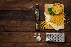 Fresh spaghetti with cheese on an old wooden table.  Royalty Free Stock Photo