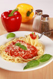 Fresh spaghetti meal. Fresh spaghettis are served with tomato sauce, basil and Parmesan cheese royalty free stock photo