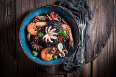 Fresh spaghetti with seafood made of octopus, tiger prawns Royalty Free Stock Image