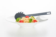 Fresh spaghetti with tomato and basil stock photography