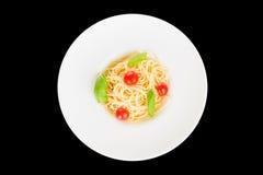 Fresh spaghetti with tomato and basil Stock Photo