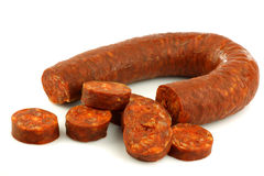 Fresh Spanish chorizo sausage with some cut pieces. On a white background stock images