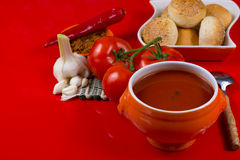 Fresh spiced tomato soup with garlic, pepper and bread Stock Photo