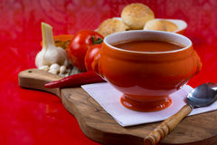 Fresh spiced tomato soup with garlic, pepper and bread Royalty Free Stock Images