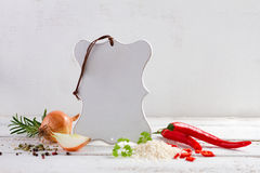 Fresh spices and vegetables with cutting board Royalty Free Stock Photo