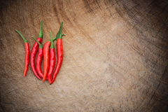 Fresh and spicy cayenne on wooden chop board Stock Photography