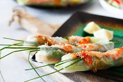 Fresh spicy vietnamese salad rolls with shrimp on a white plate Stock Photos