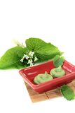 Fresh spicy Wasabi with leaf and blossom Royalty Free Stock Image