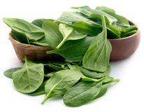 Fresh Spinach. In basket over white background Stock Photo