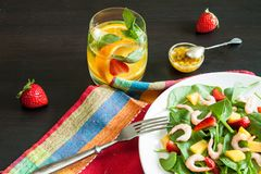 Fresh spinach fruit salad. Royalty Free Stock Image
