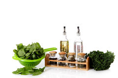 Fresh spinach and herbs, vinegar and oil Royalty Free Stock Photo