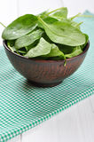Fresh spinach leaves in bowl Royalty Free Stock Image