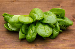 Fresh spinach leaves on wood. Some leaves Fresh spinach on wooden table Stock Photos