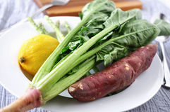 Fresh Spinach with Lemon and Sweet Potato Royalty Free Stock Image