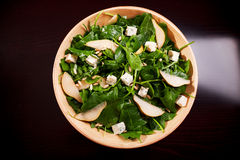 Fresh spinach salad with blue cheese, pears and honey Stock Photos