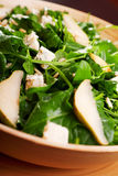 Fresh spinach salad with blue cheese, pears and honey Royalty Free Stock Images