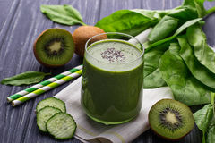 Fresh spinach smoothie with kiwi and cucumber. Selective focus stock photo