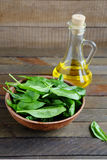 Fresh spinach and sunflower oil Royalty Free Stock Images
