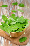 Fresh spinach in a wooden bowl, vertical Stock Photos