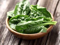 Spinach in a wooden plate Stock Photo