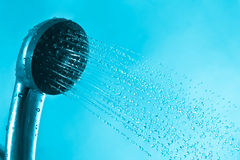 Fresh splash bath shower and current blue water Royalty Free Stock Photos